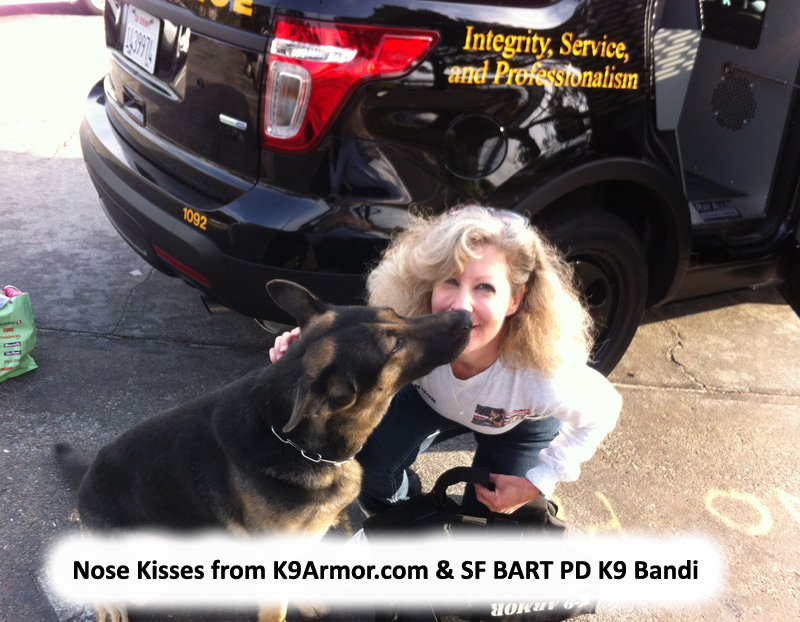 BART PD K9 Bandi giving kisses to K9 Armor cofounder Suzanne Saunders, photo by Officer Edwards