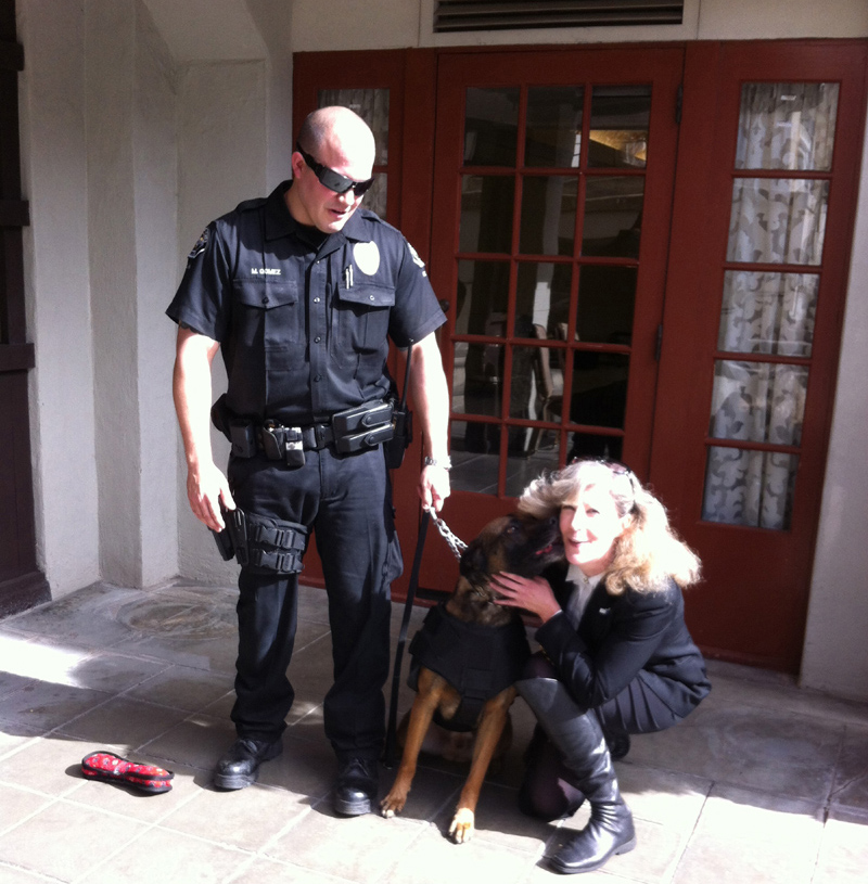 Hemet PD Officer Matt Gomez and K9 Jack giving kisses to K9 Armor Cofounder Suzanne Saunders