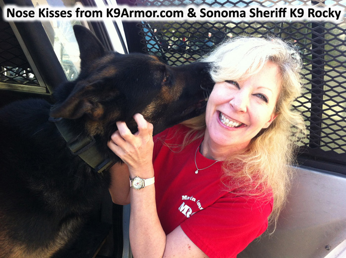 Nose kisses from Sonoma County Sheriff K9 Rocky  and Suzanne Saunders giving Rocky a K9 Armor vest. Photo by Deputy Mason