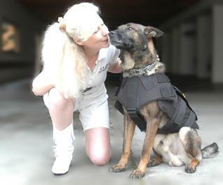St Helena PD K9 Djino gives K9 Armor Cofounder Suzanne Saunders a kiss for his new bulletproof vest