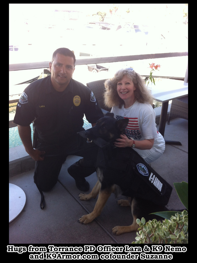 Hugs from Torrance Police Officer Lara and K9 Nemo wearing his bulletproof vest with K9Armor.com co-founder Suzanne Saunders.